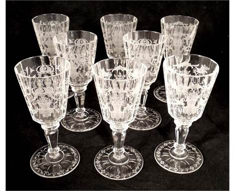 Included in this auction are 8 Lobmeyr clear crystal stems. They feature a round, paneled fluted and faceted intaglio cut bow