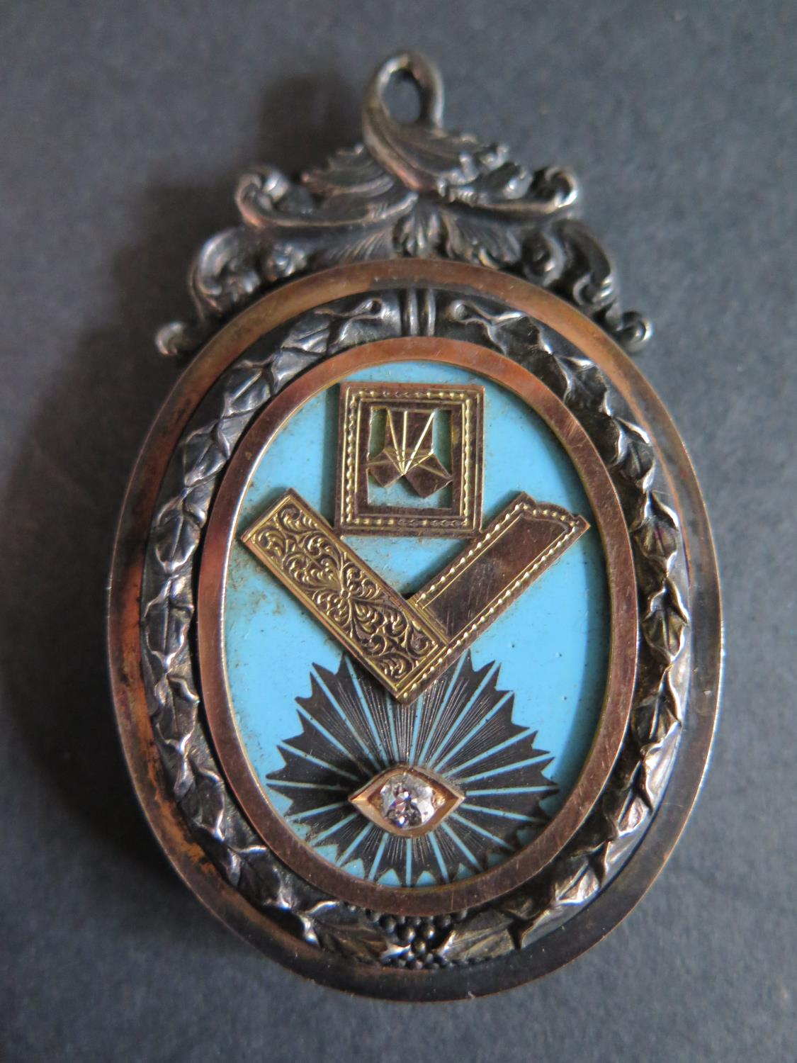 Lot 334D - A Victorian Masonic Jewel with diamond 'eye' EDW .17ct