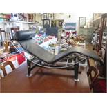 An LC4 Chaise Longue with chrome and black base and black ;leather upholstery, designed by Le
