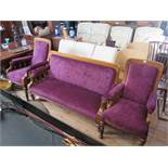 A Victorian Oak Three Piece Salon Suite in new purple plush upholstery and stool (matches previous