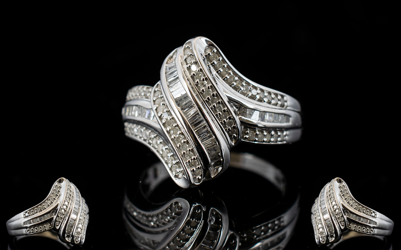 Lot 145 - Diamond 'Wave' Ring, a row of baguette c