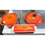 A Le Creuset orange enamelled casserole dish; an aluminium fish kettle; three pestles; two