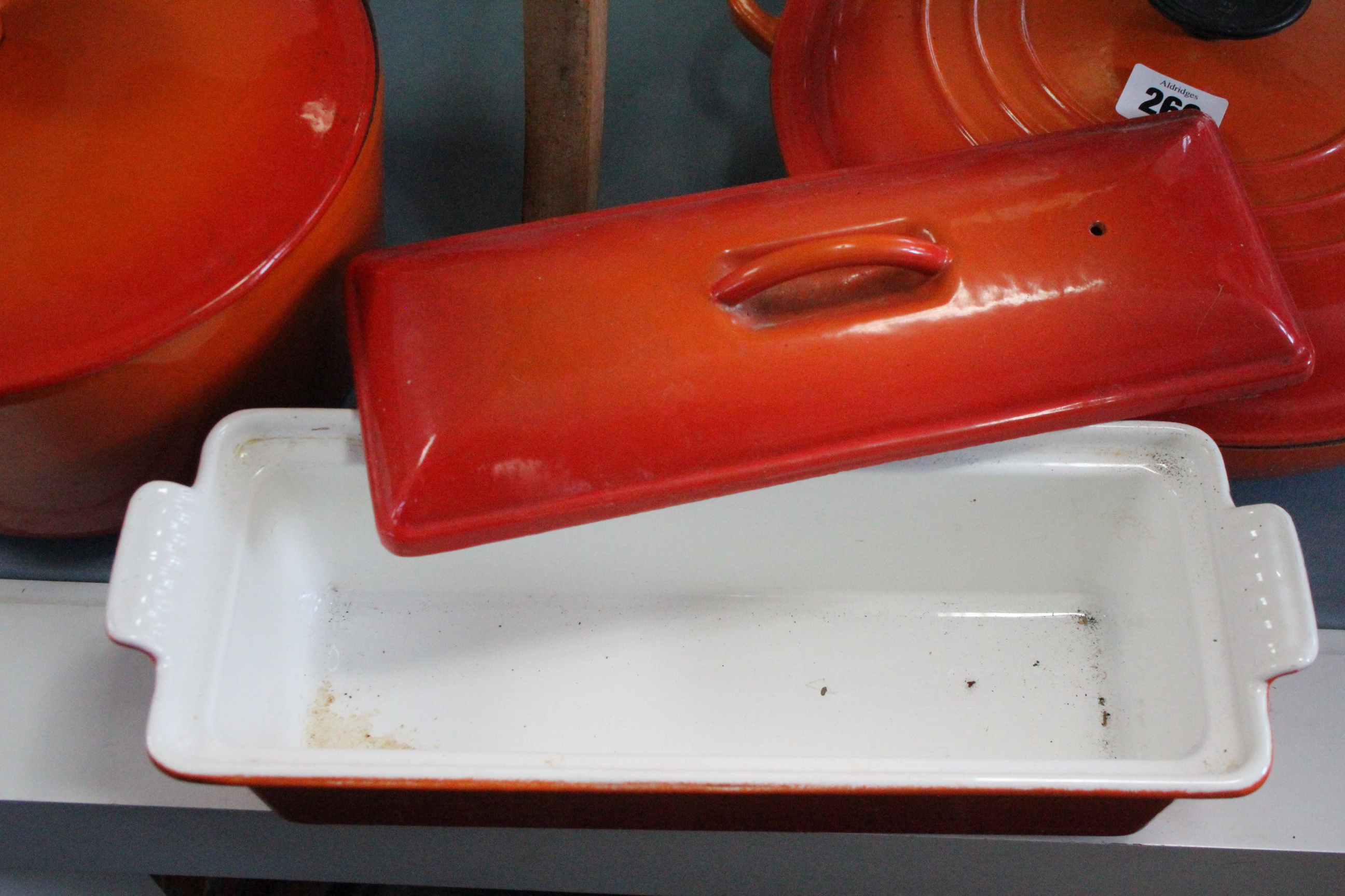 Lot 260 - A Le Creuset orange enamelled casserole dish; an aluminium fish kettle; three pestles; two