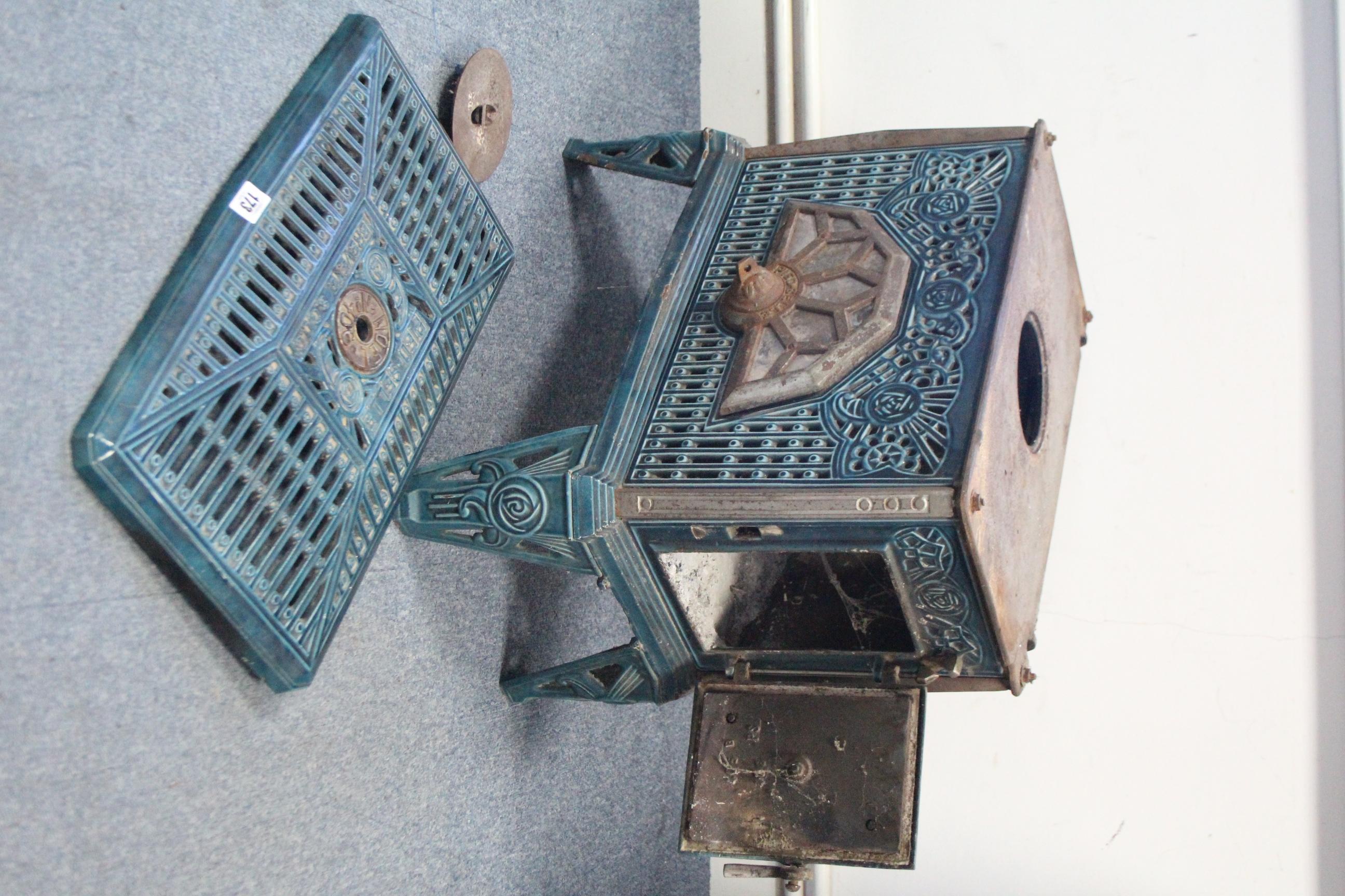 "Lot 173 - A Brevette ""No. 406 Noel"" Pied Selle turquoise enamelled cast-iron wood burner, 20¼"" wide."