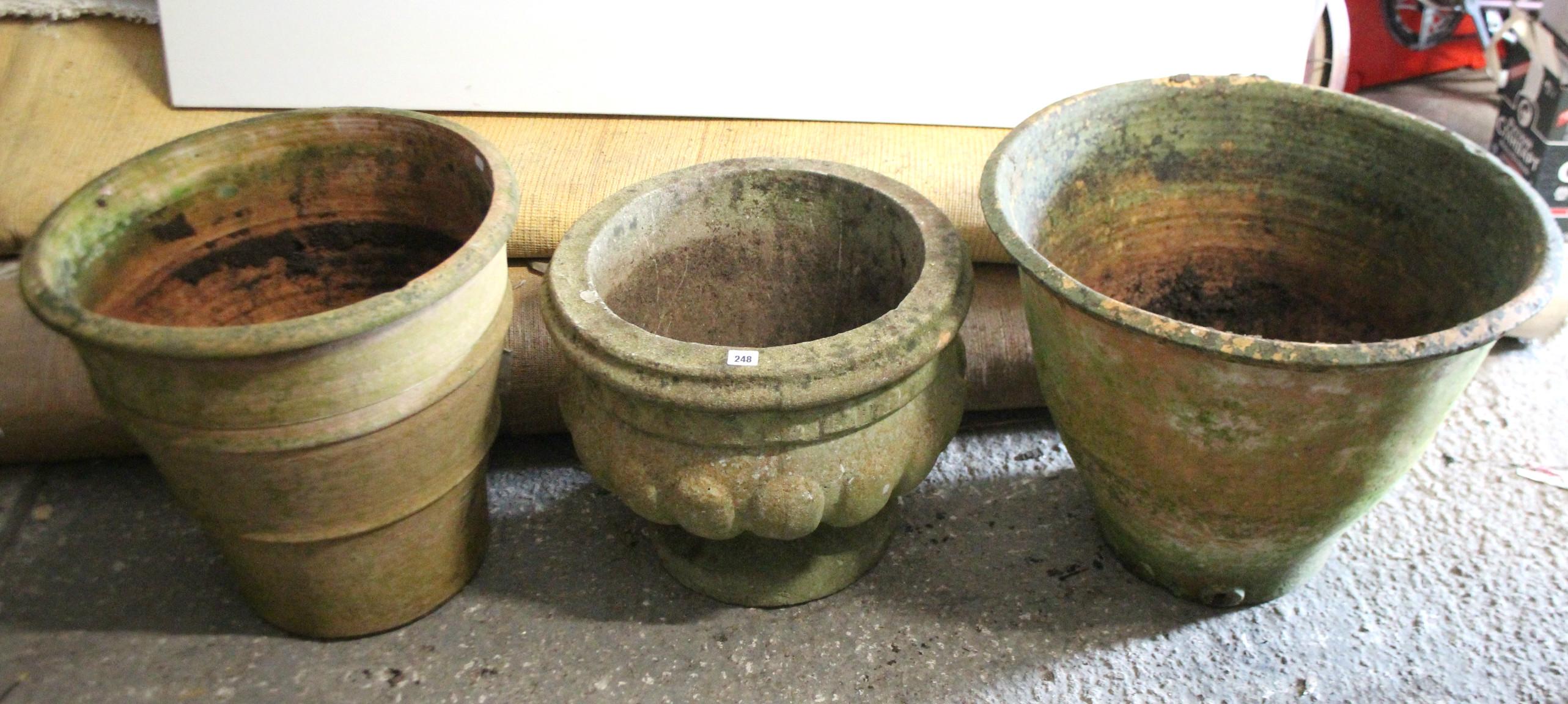 "Lot 248 - A reconstituted stone circular garden urn on round pedestal foot, 20"" diameter 16½"" high; together"
