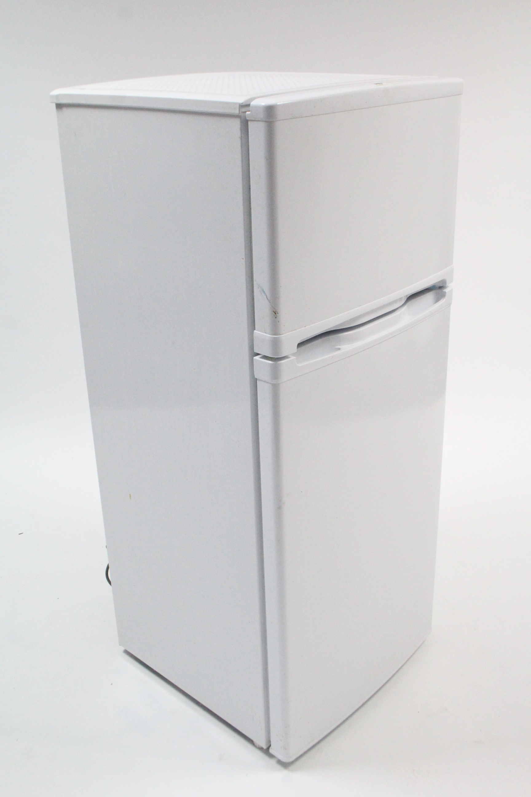 "Lot 309 - A small upright fridge-freezer in white finish case, w.o. 44½"" high."