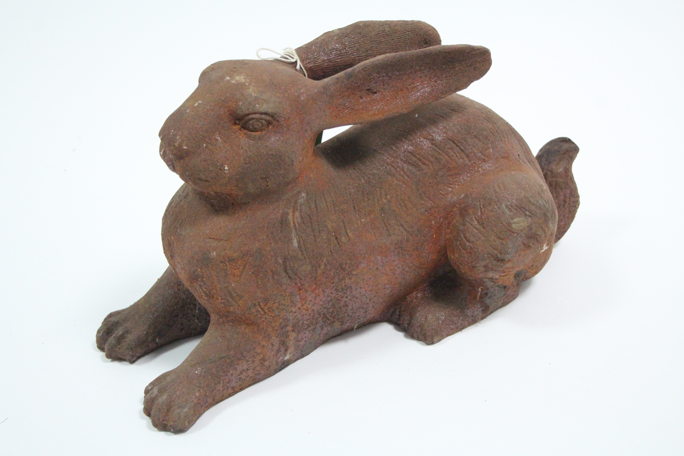 "Lot 106 - A large cast-iron garden ornament in the form of a recumbent hare, 14"" wide."
