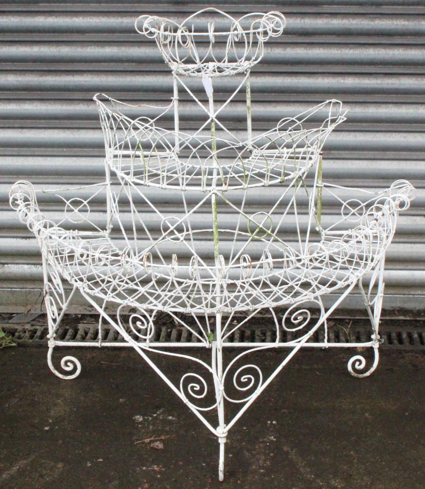 "Lot 227 - A Victorian white painted wrought-iron demi-lune three-tier plant stand, 36"" wide x 35½"" high."