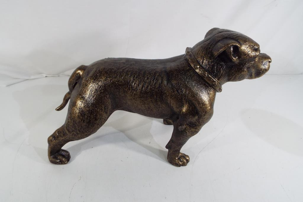 Lot 15 - A cast bronzed statue depicting a pit bull,