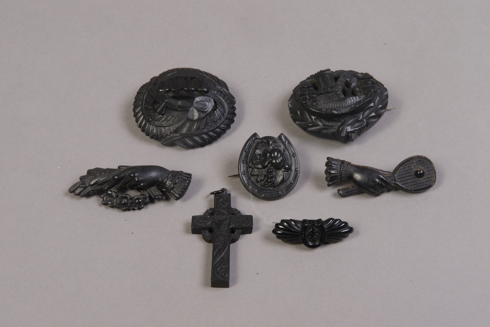 Lot 232 - Six 19th century bog oak brooches includ