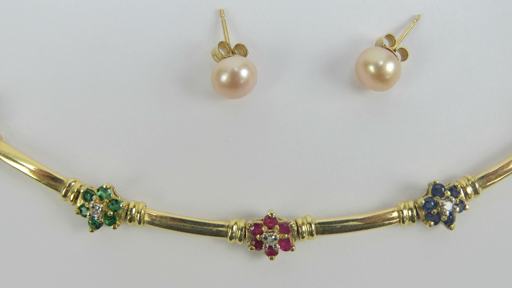 Lot 114 - A 14ct gold bracelet having six floral gem set panels (one stone deficient),