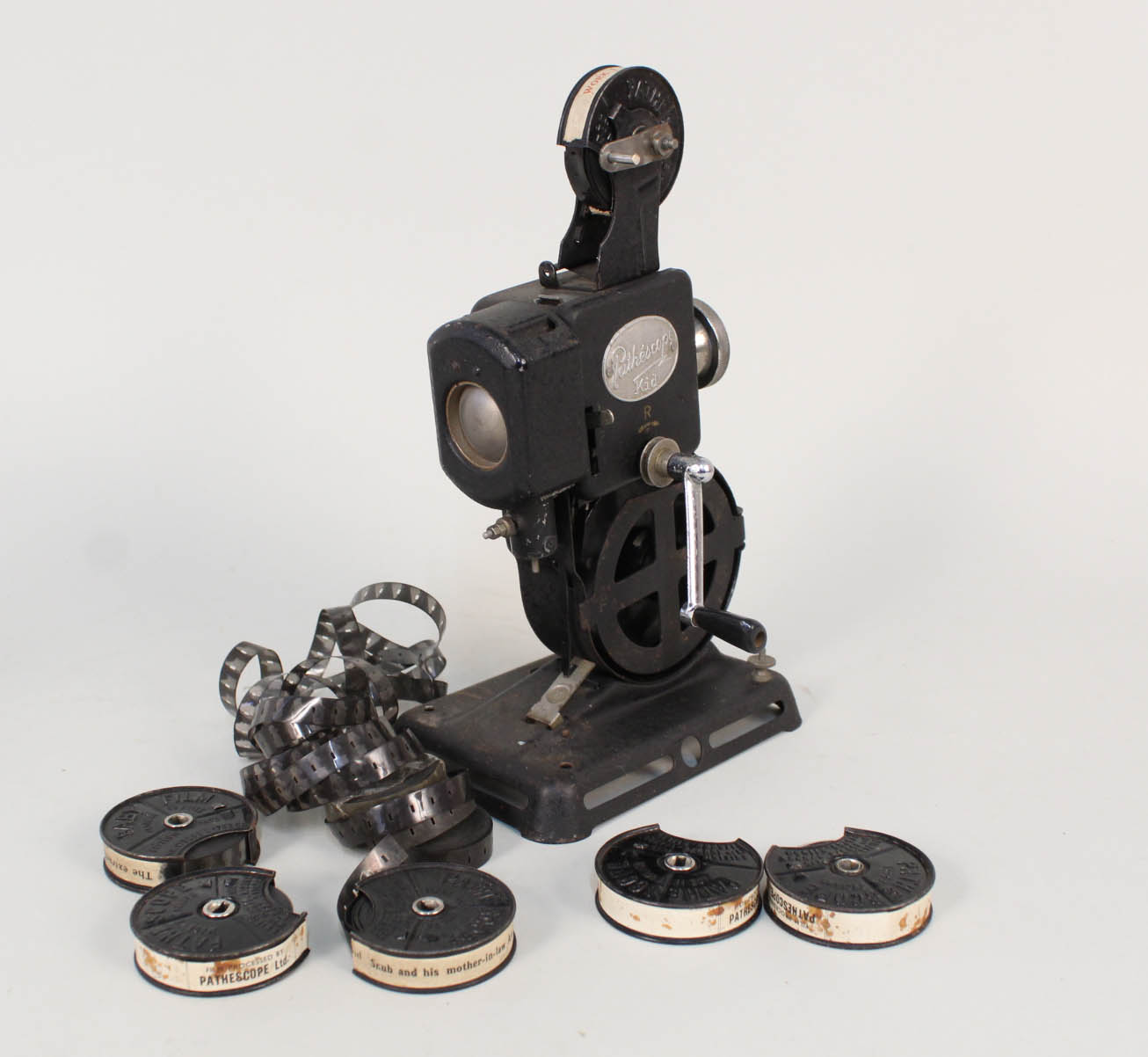Lot 38 - A Pathe kid projector and films including The Extraction of Coal and Snub and His Mother in Law