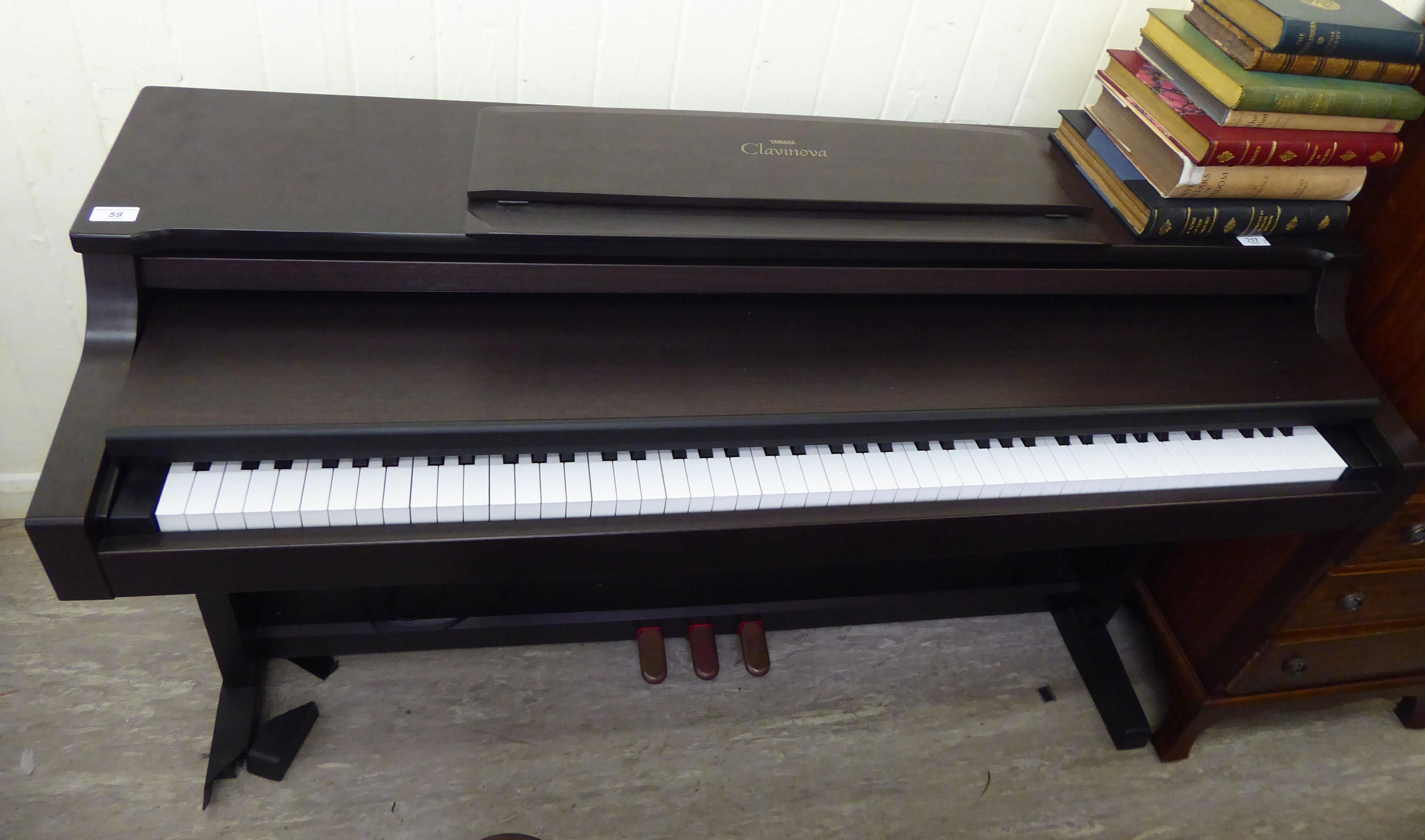 Lot 59 - A Yamaha Clavinova mahogany cased electric piano 34''h 53''w RAB