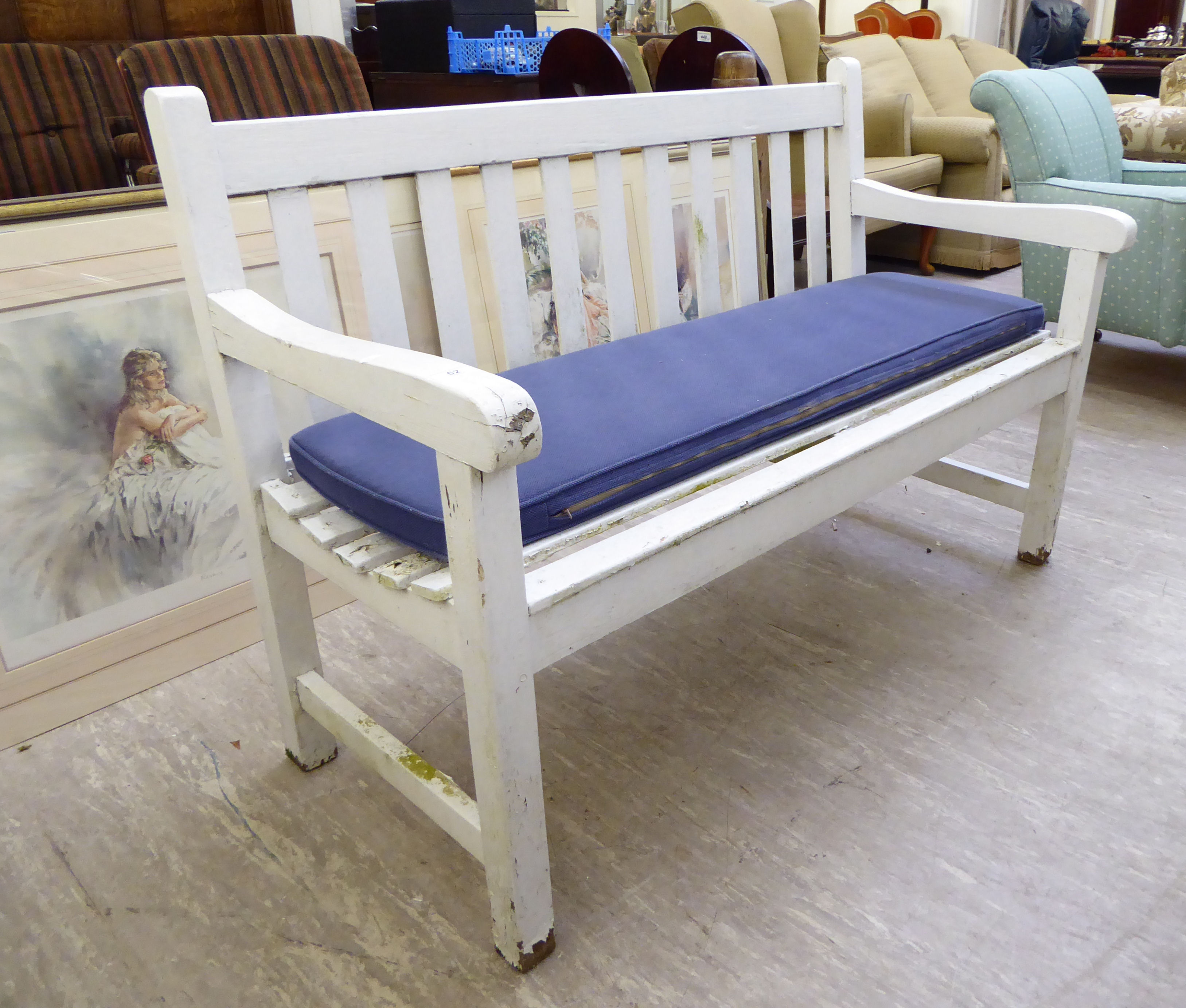 Lot 13 - A modern white painted garden bench of slatted construction,
