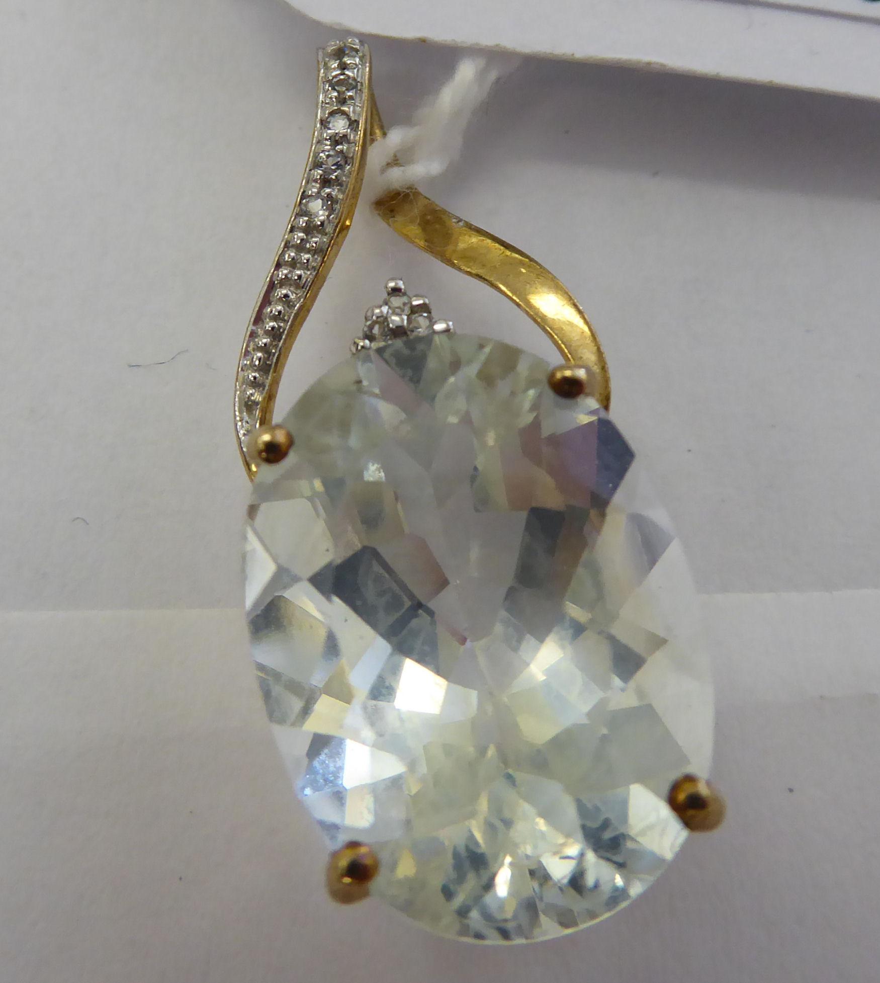 Lot 53 - A 9ct gold aquamarine and diamond set pendant 11