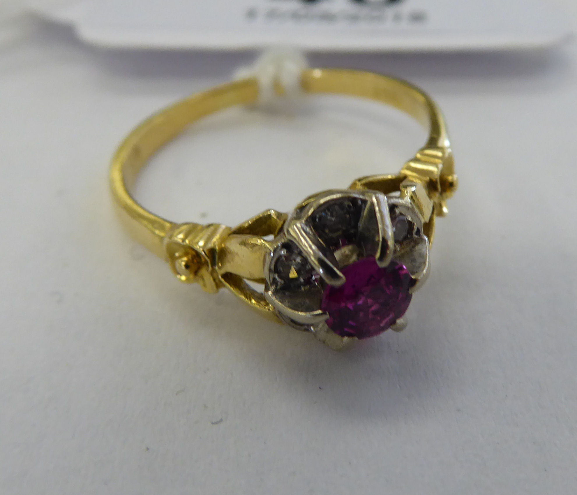 Lot 46 - An 'antique' 18ct gold ruby and diamond set cluster ring 11