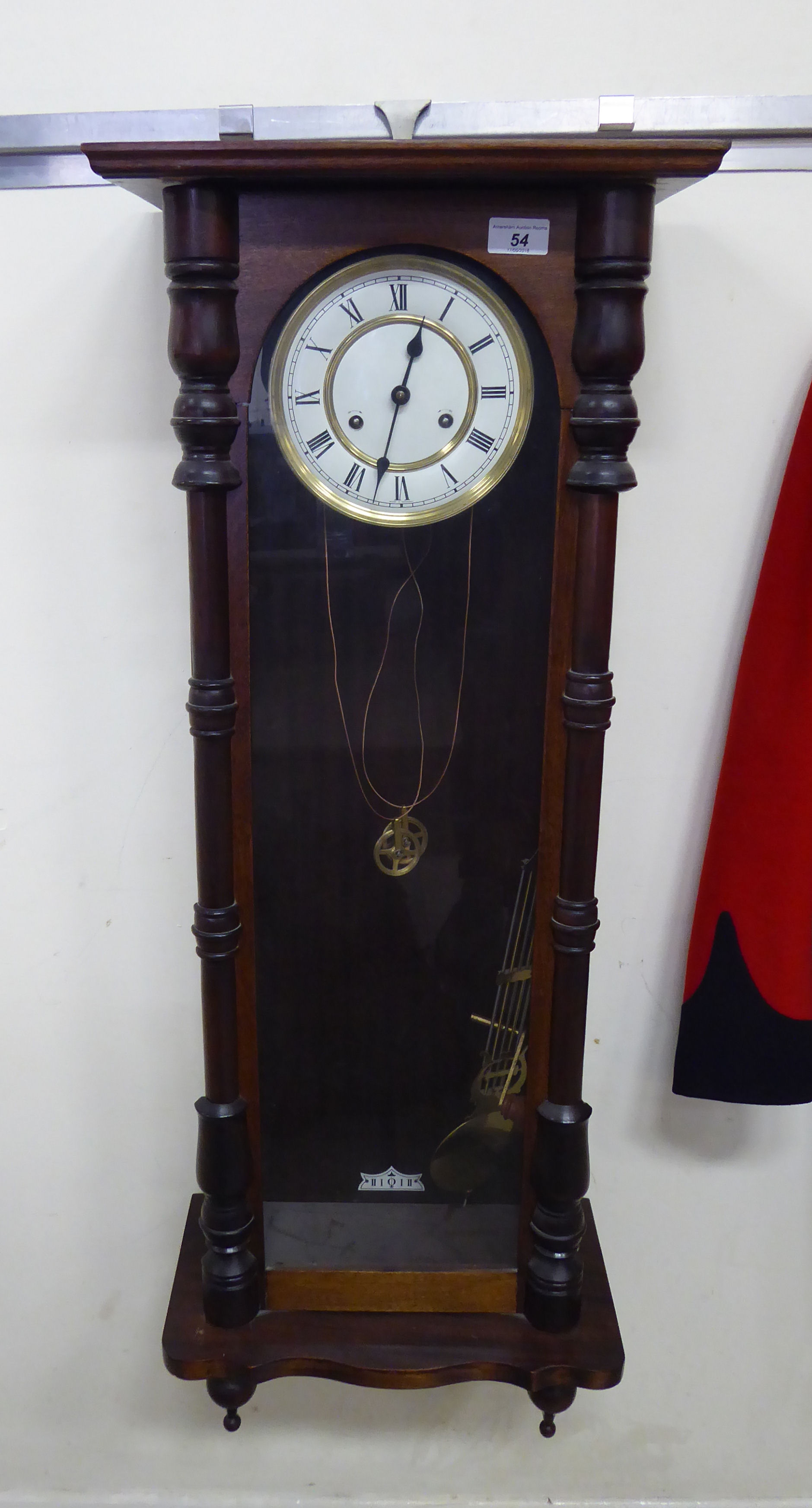 Lot 54 - An early 20thC glazed mahogany cased Vienna wall clock with turned pilasters and drop finials;