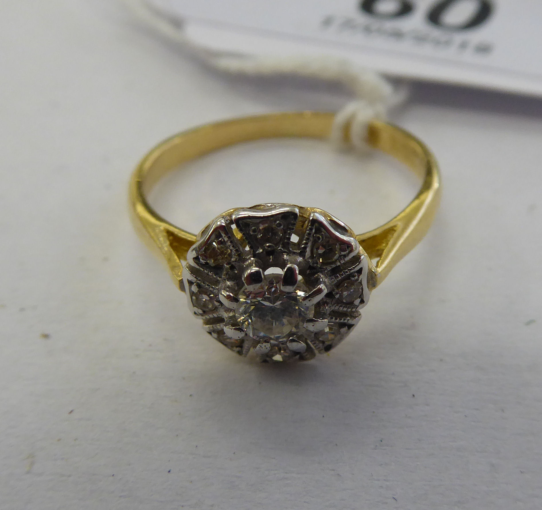 Lot 60 - An 18ct gold diamond cluster ring 11