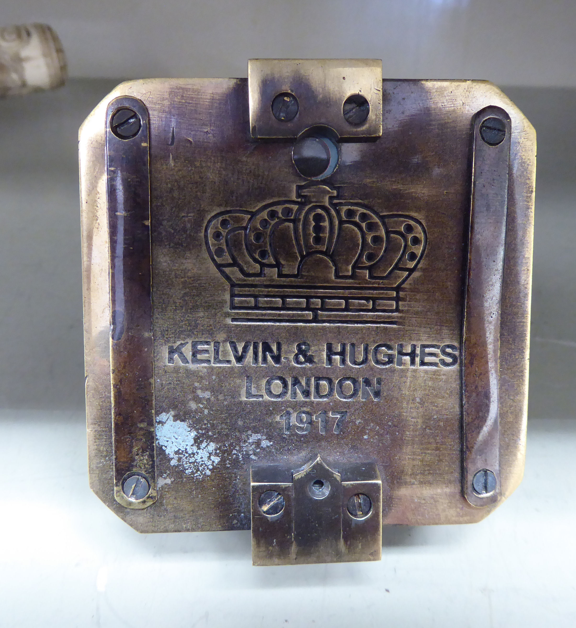 Lot 47 - A reproduction of an early 20thC brass cased military compass OS4