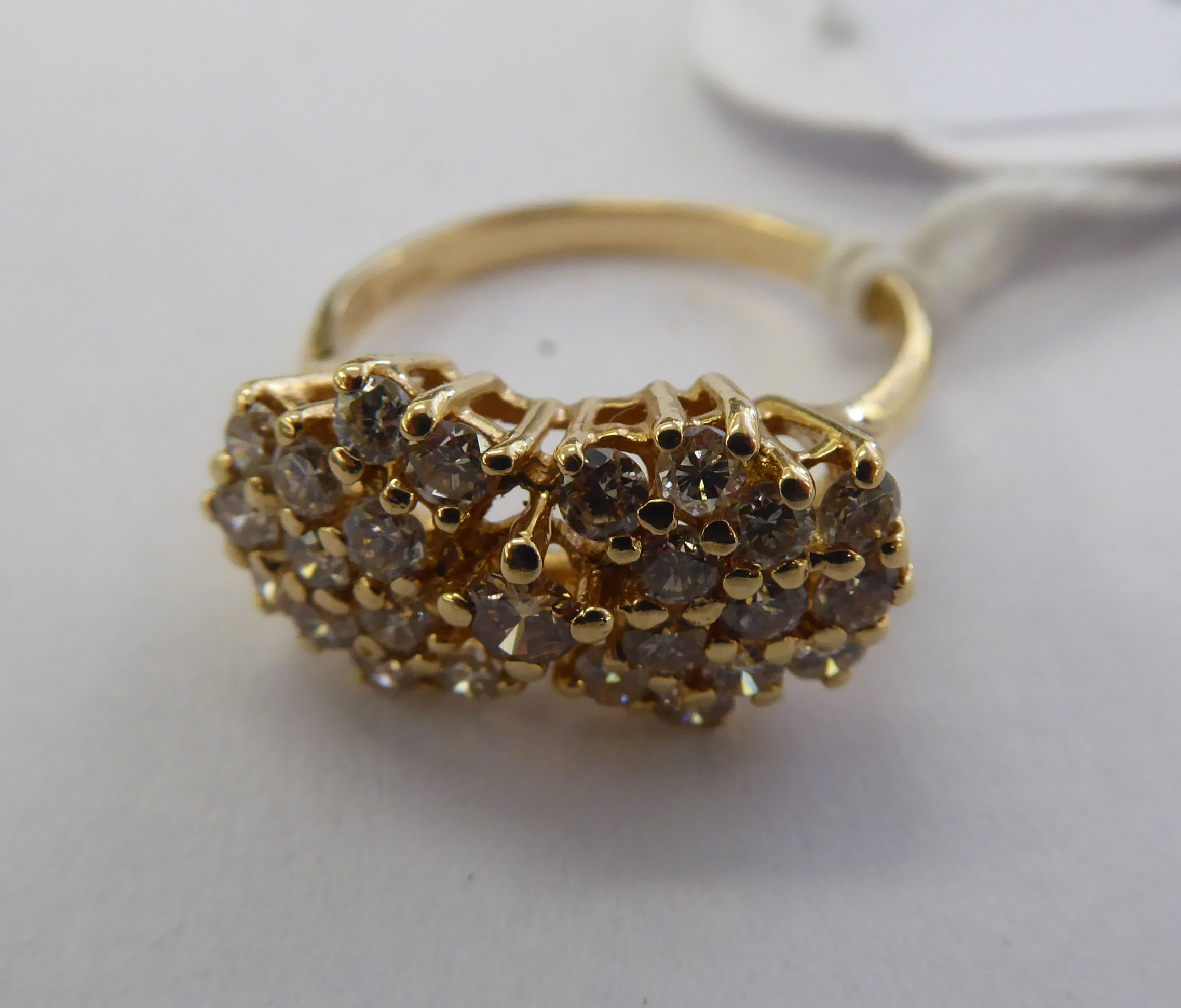 Lot 22 - A 14ct gold claw set diamond cluster ring 11