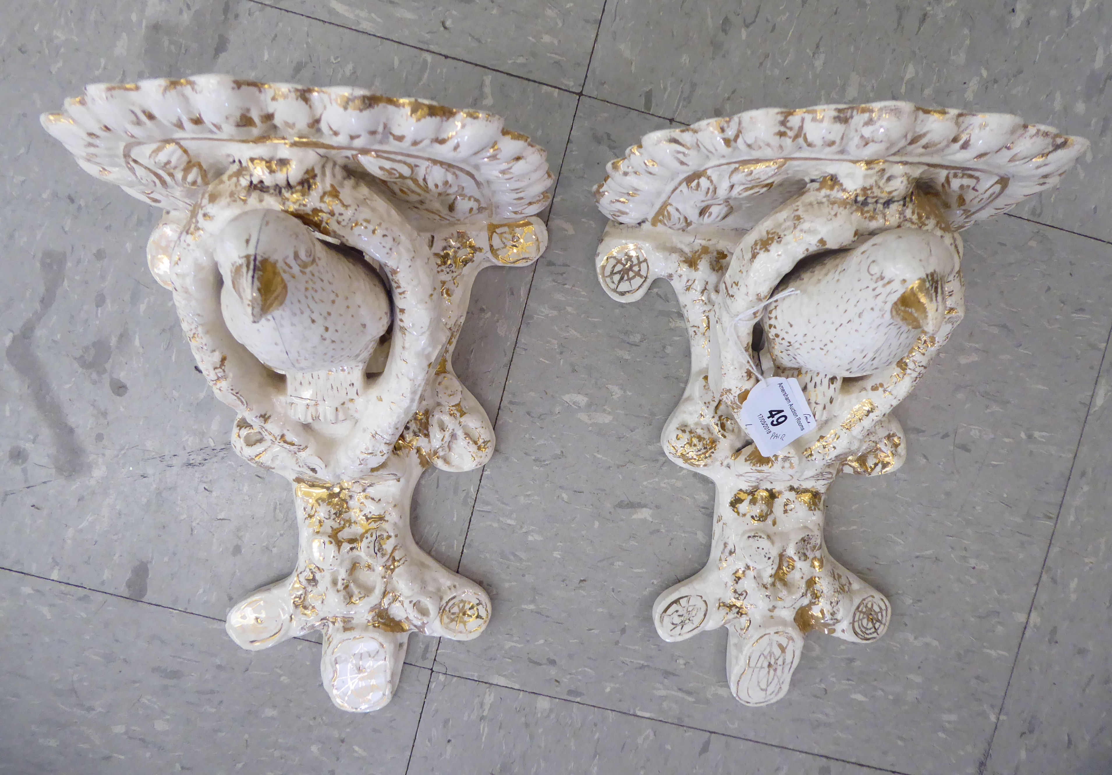 Lot 49 - A pair of late 19thC Continental porcelain moulded, glazed and gilded Chinese wall brackets,