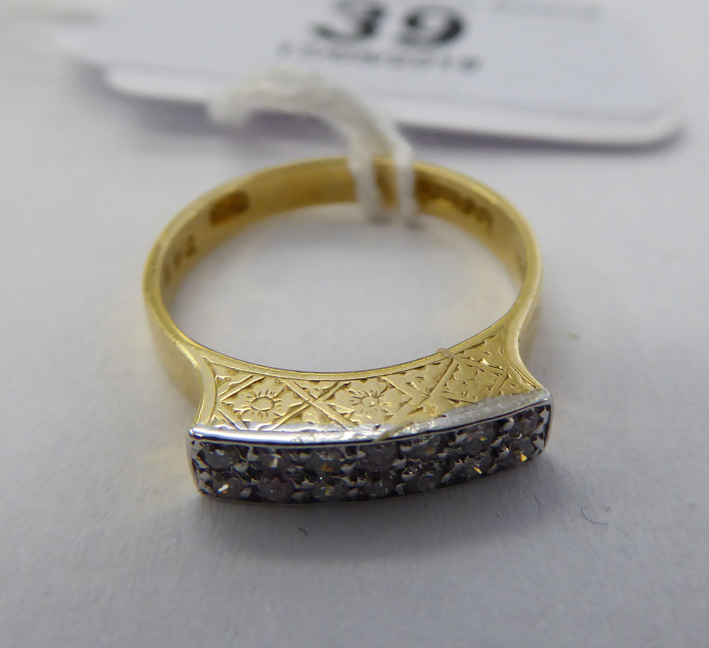 Lot 39 - An 18ct gold double row diamond ring 11