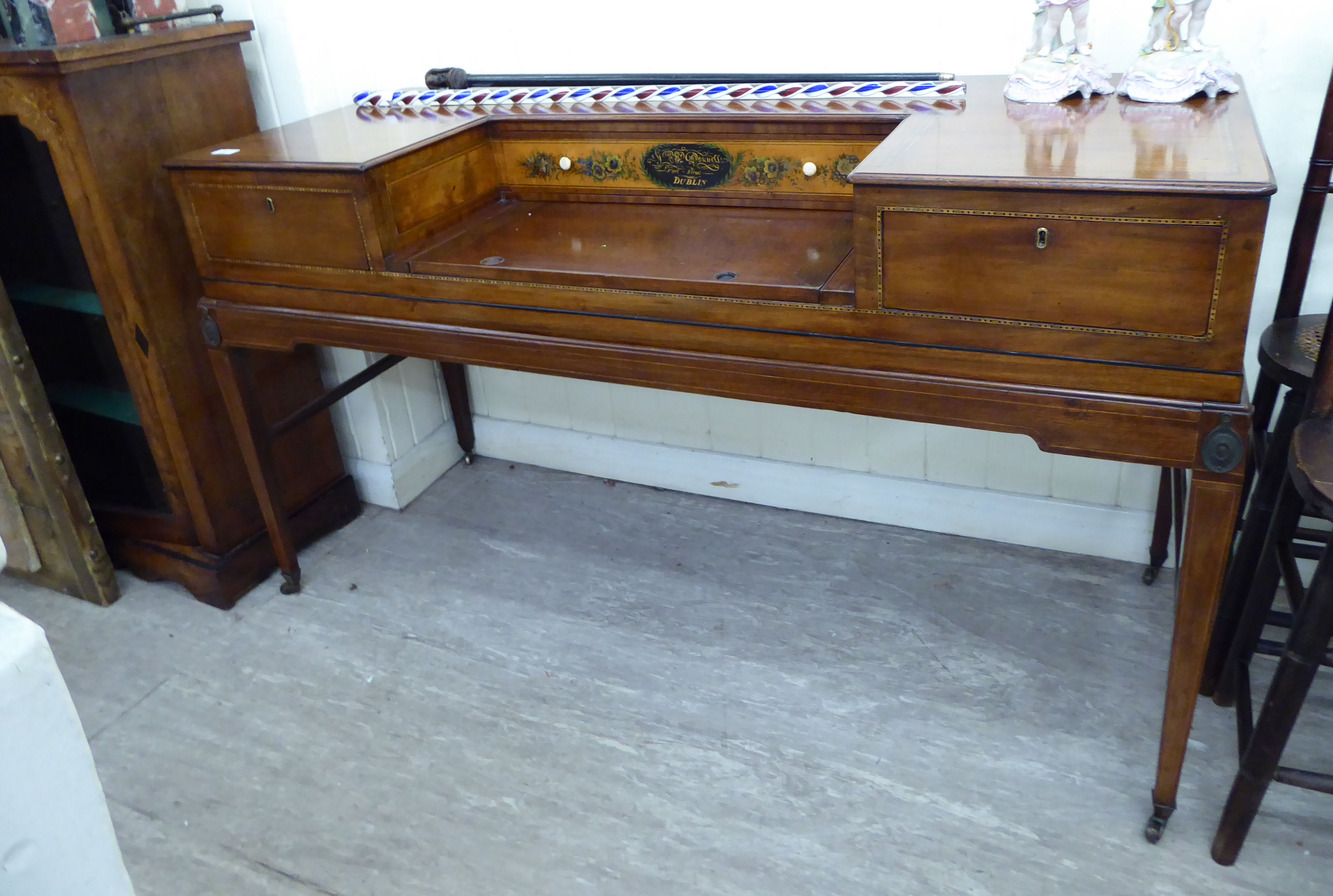 Lot 57 - A Regency satinwood inlaid spinet, converted into a desk with three drawers, raised on square,