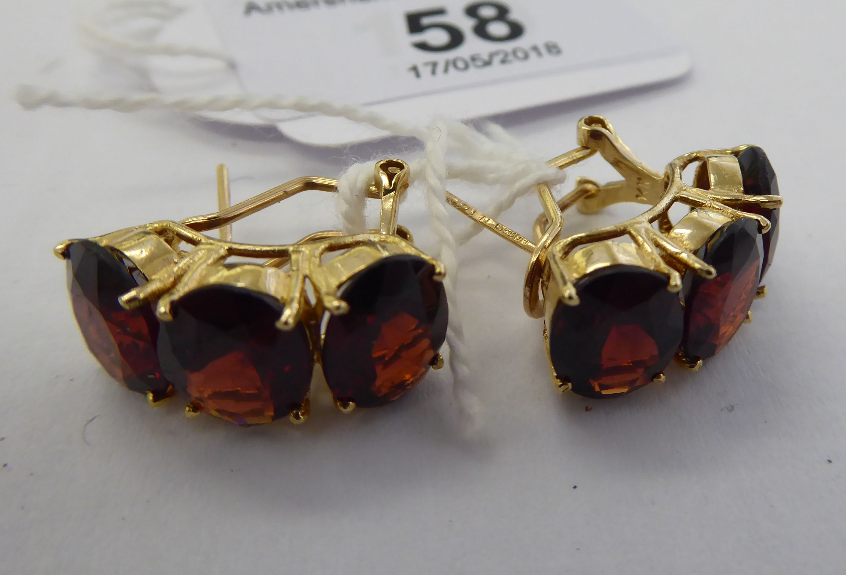 Lot 58 - A pair of 14ct gold three stone,