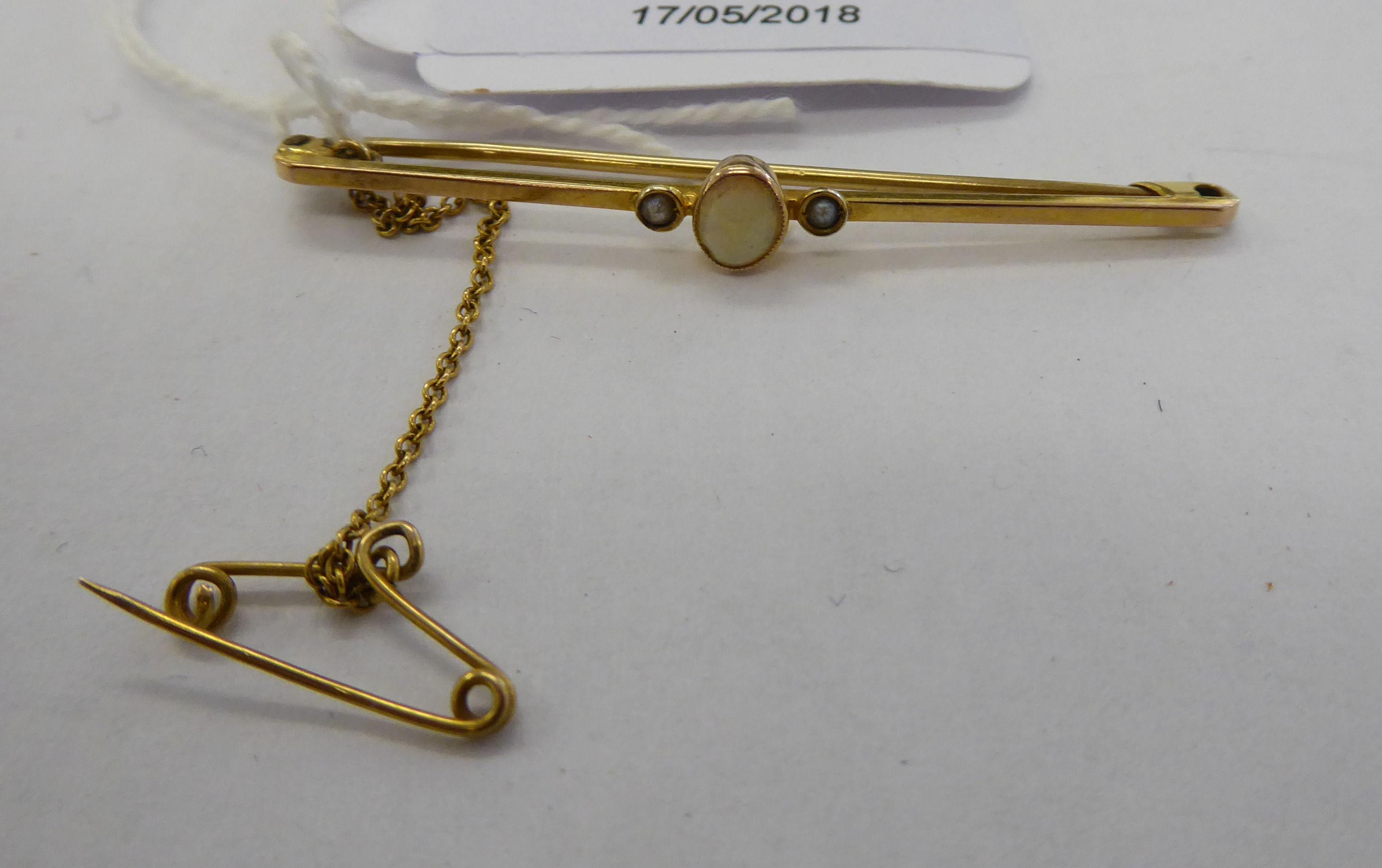 Lot 48 - An 'antique' 9ct gold opal set bar brooch 11
