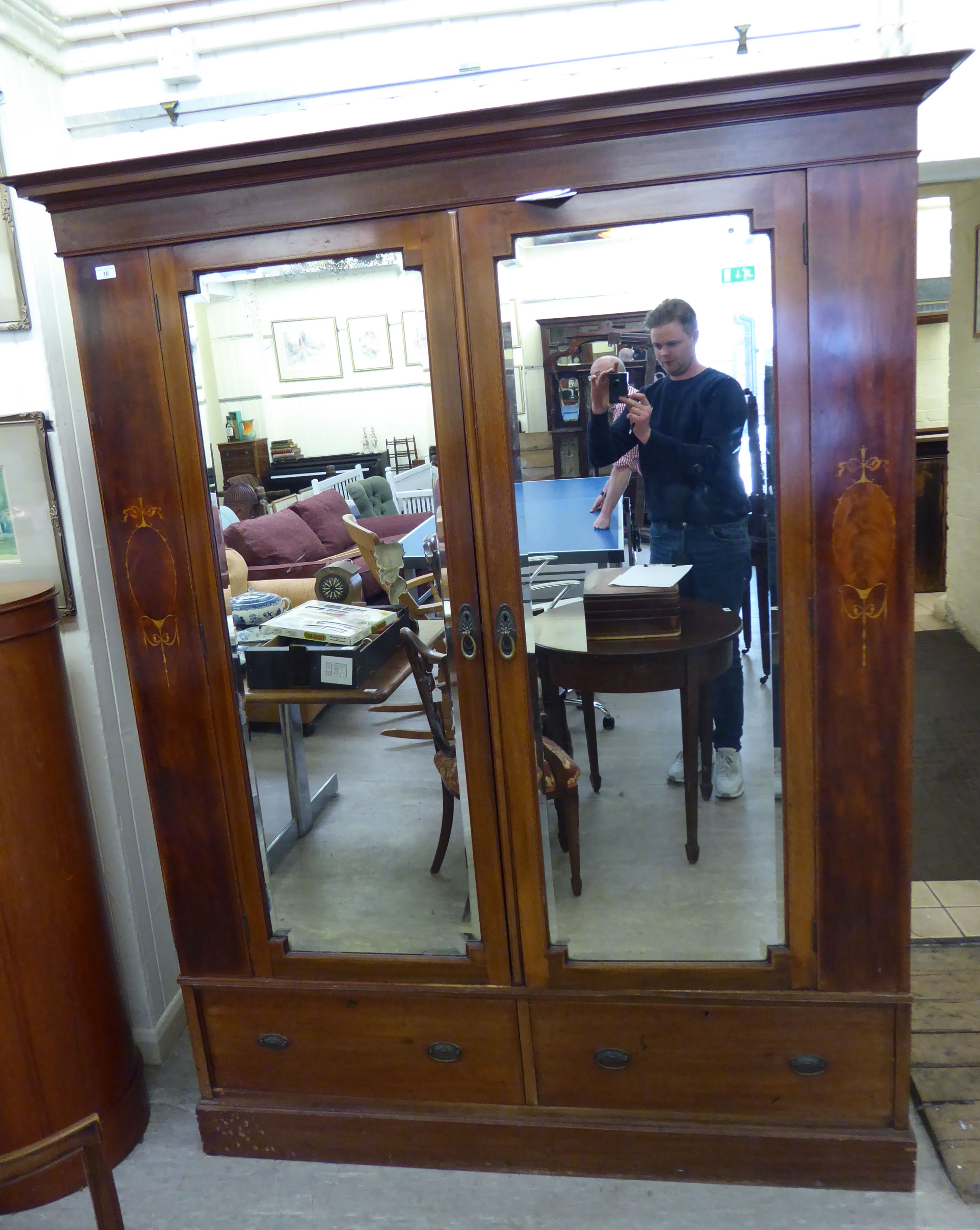 Lot 18 - A late Victorian satinwood inlaid mahogany wardrobe with two mirrored doors and two drawers,