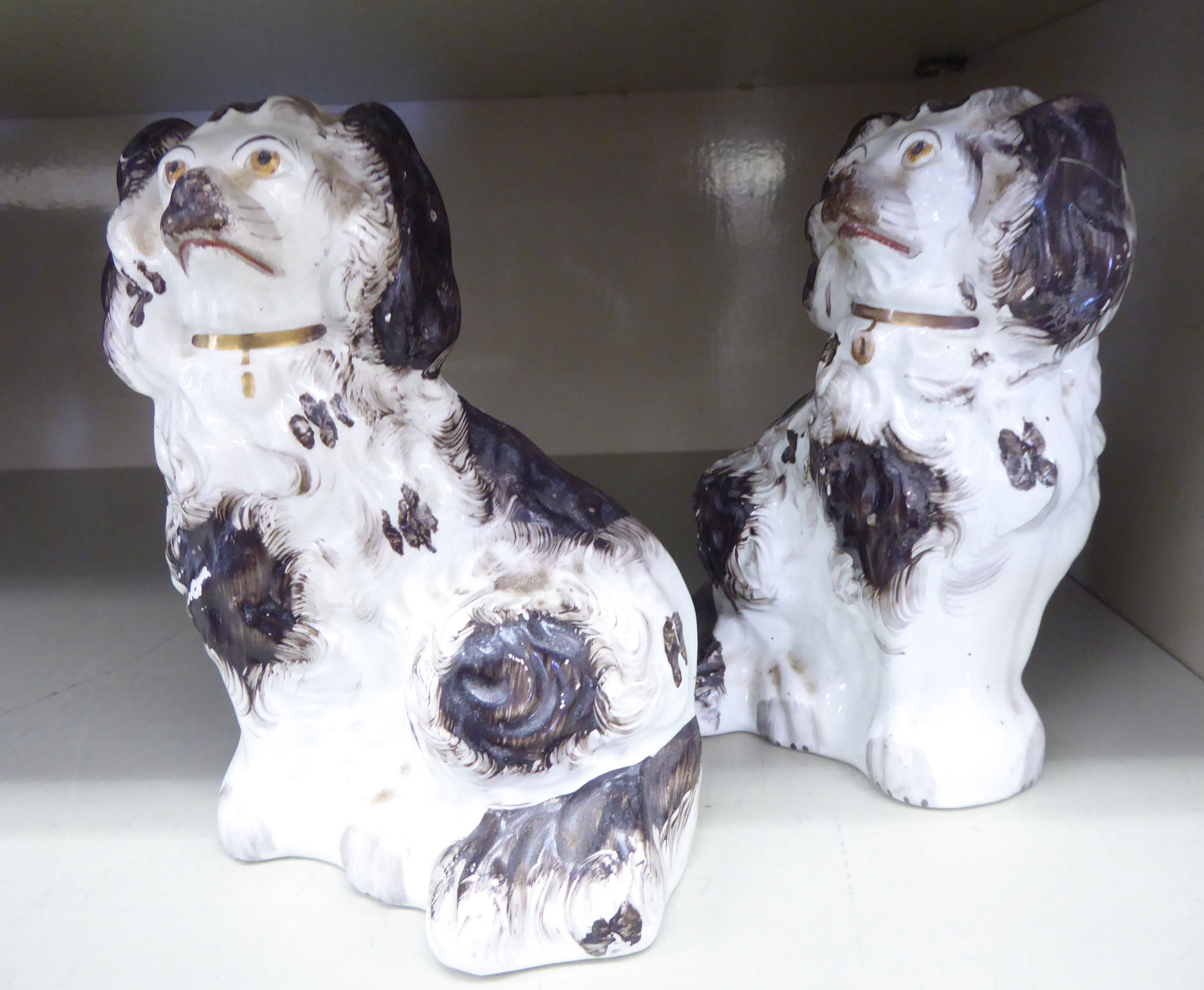 Lot 10 - A pair of 19thC Staffordshire ivory glazed pottery models,