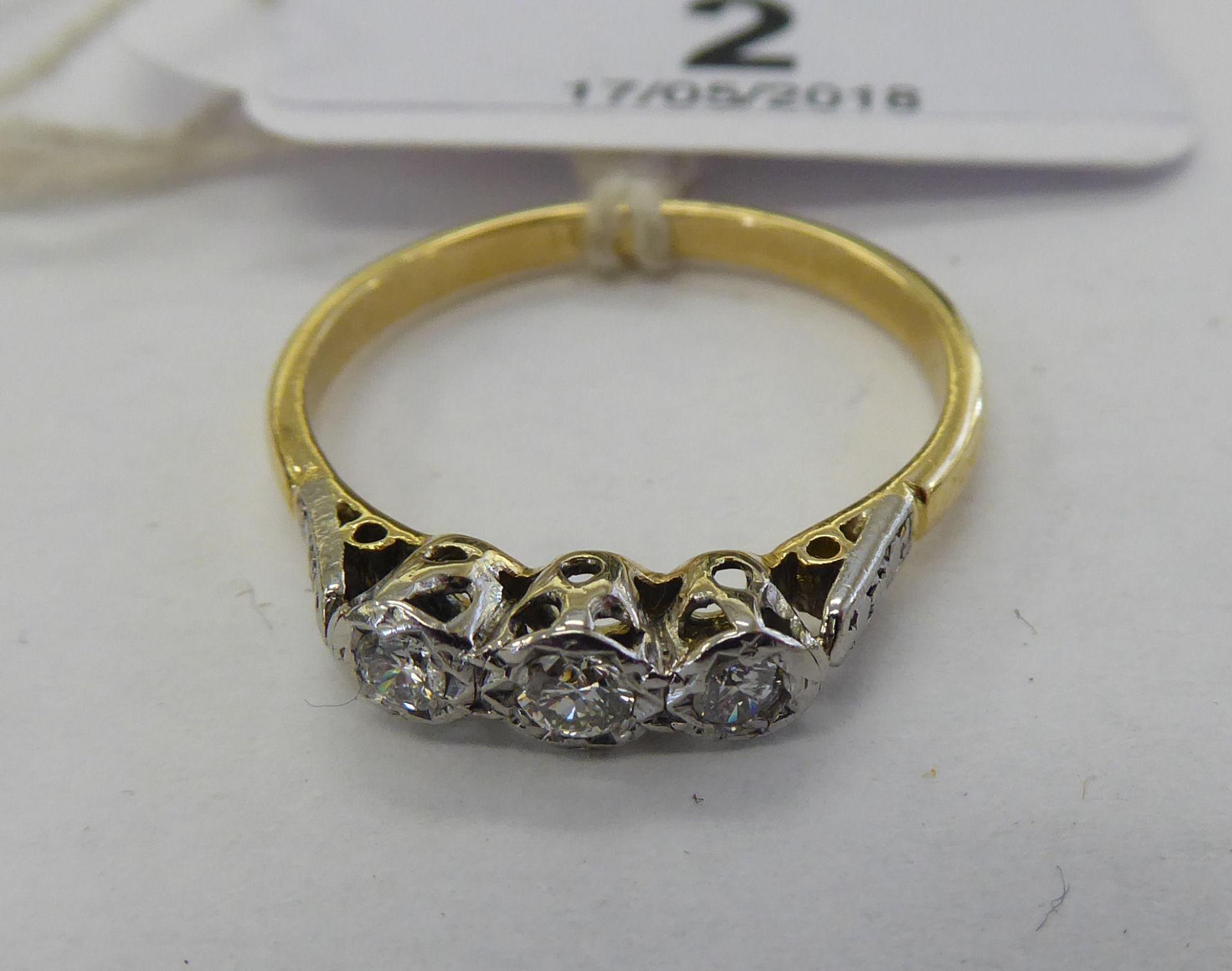 Lot 2 - An 18ct gold three stone diamond ring 11