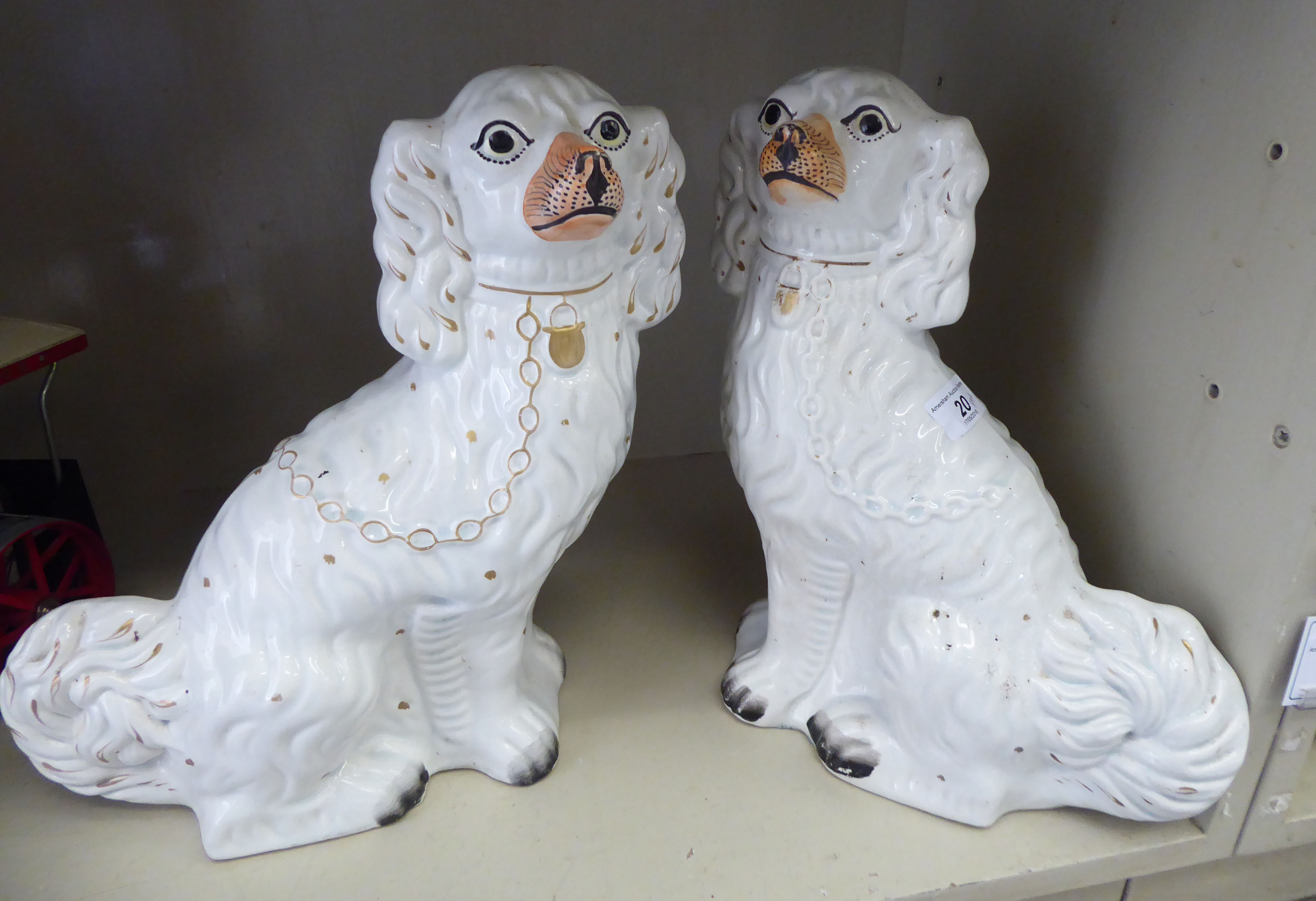 Lot 20 - A pair of late Victorian Staffordshire pottery, ivory glazed models,
