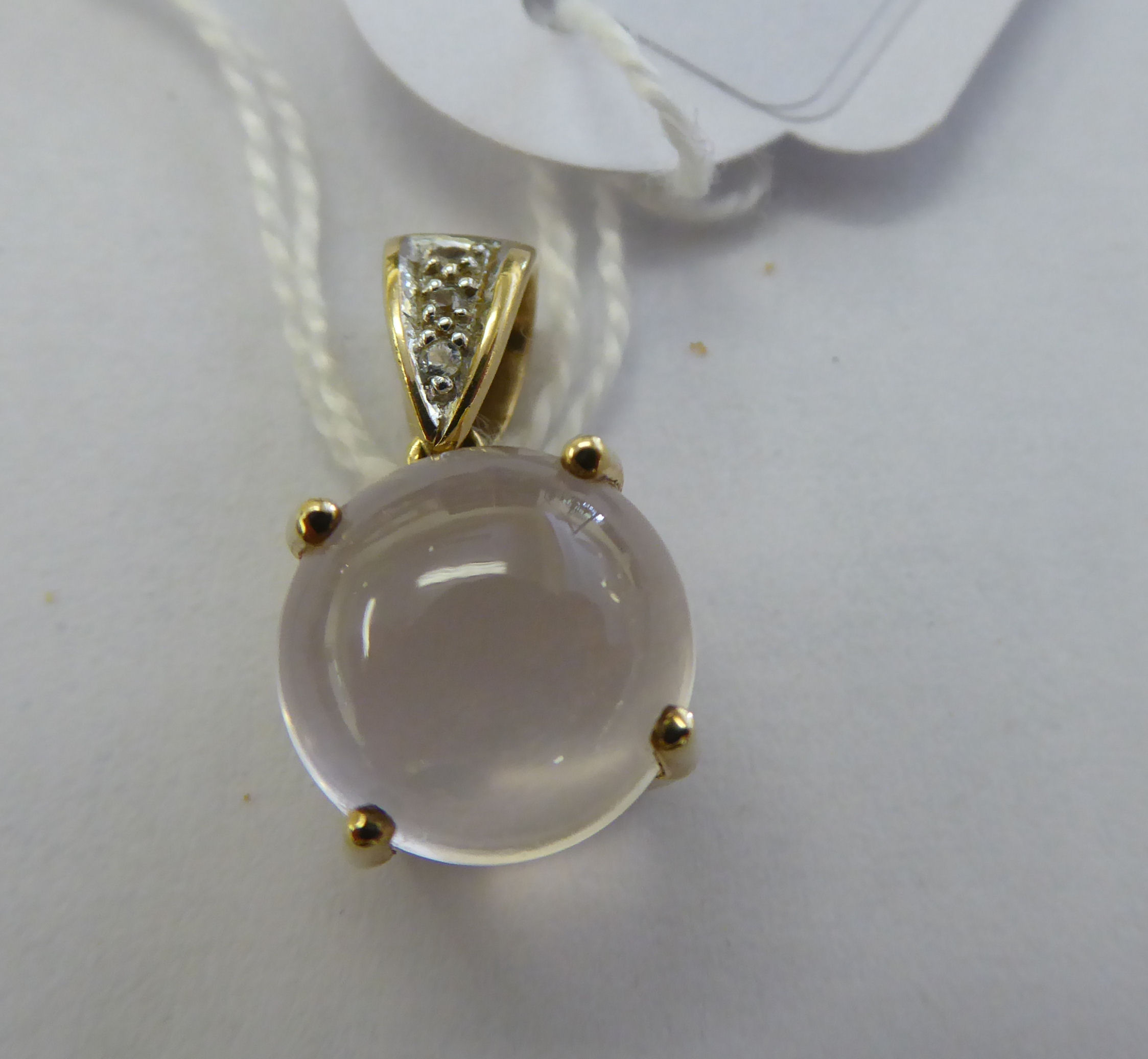 Lot 24 - A 9ct gold claw set moonstone and diamond pendant 11