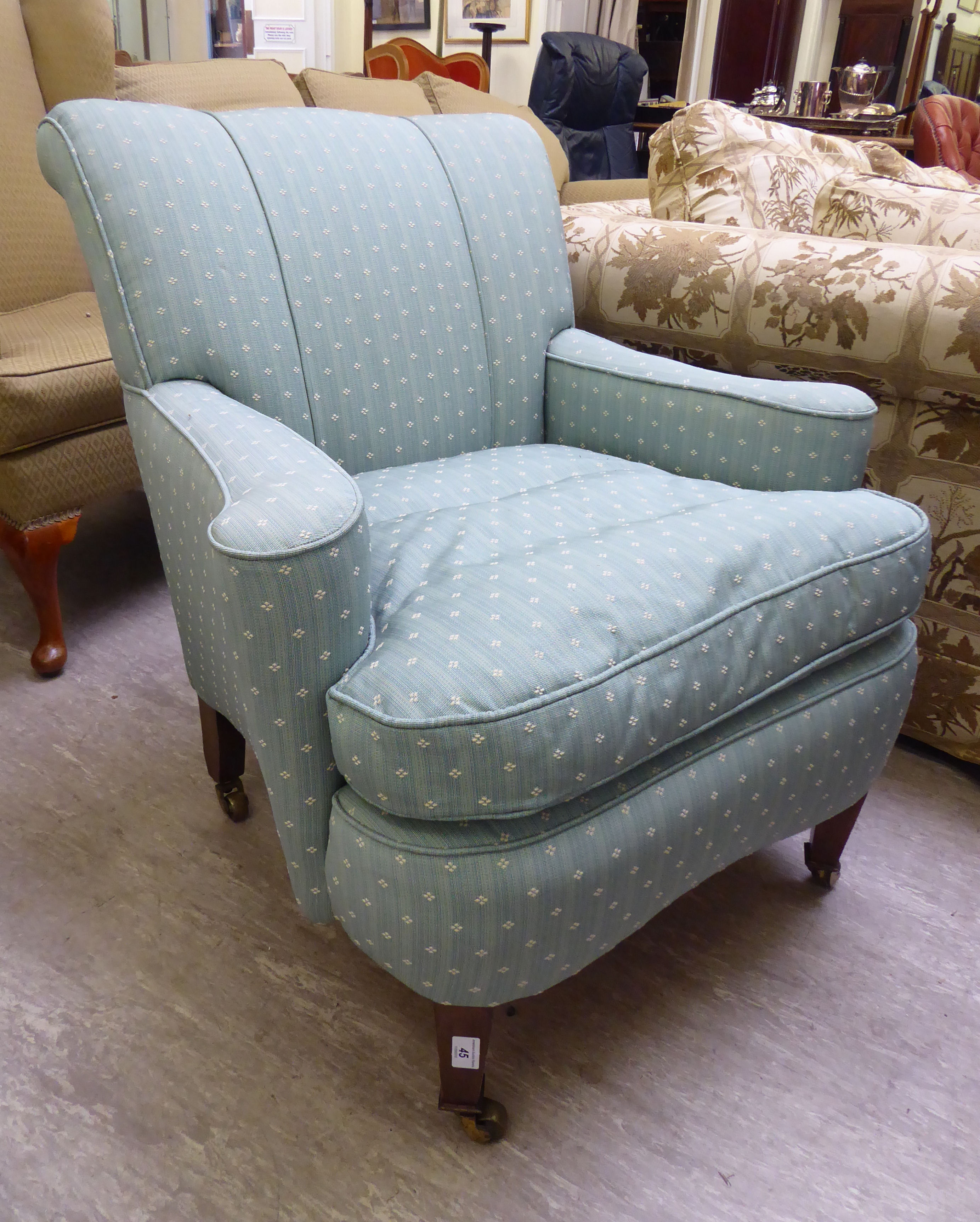 Lot 45 - A late Victorian salon chair, upholstered in pale green fabric, raised on mahogany, square,