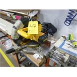 "DeWalt 10"" mitre saw c/w (2) worktables & pneumatic unit, length stop [Winner will be determined"
