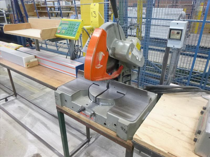 "Lot 13 - Elumatec 14"" single mitre saw, mod. MGS72, ser. no. 32282 (ca. 1986) c/w Tiger Stop system & tables"