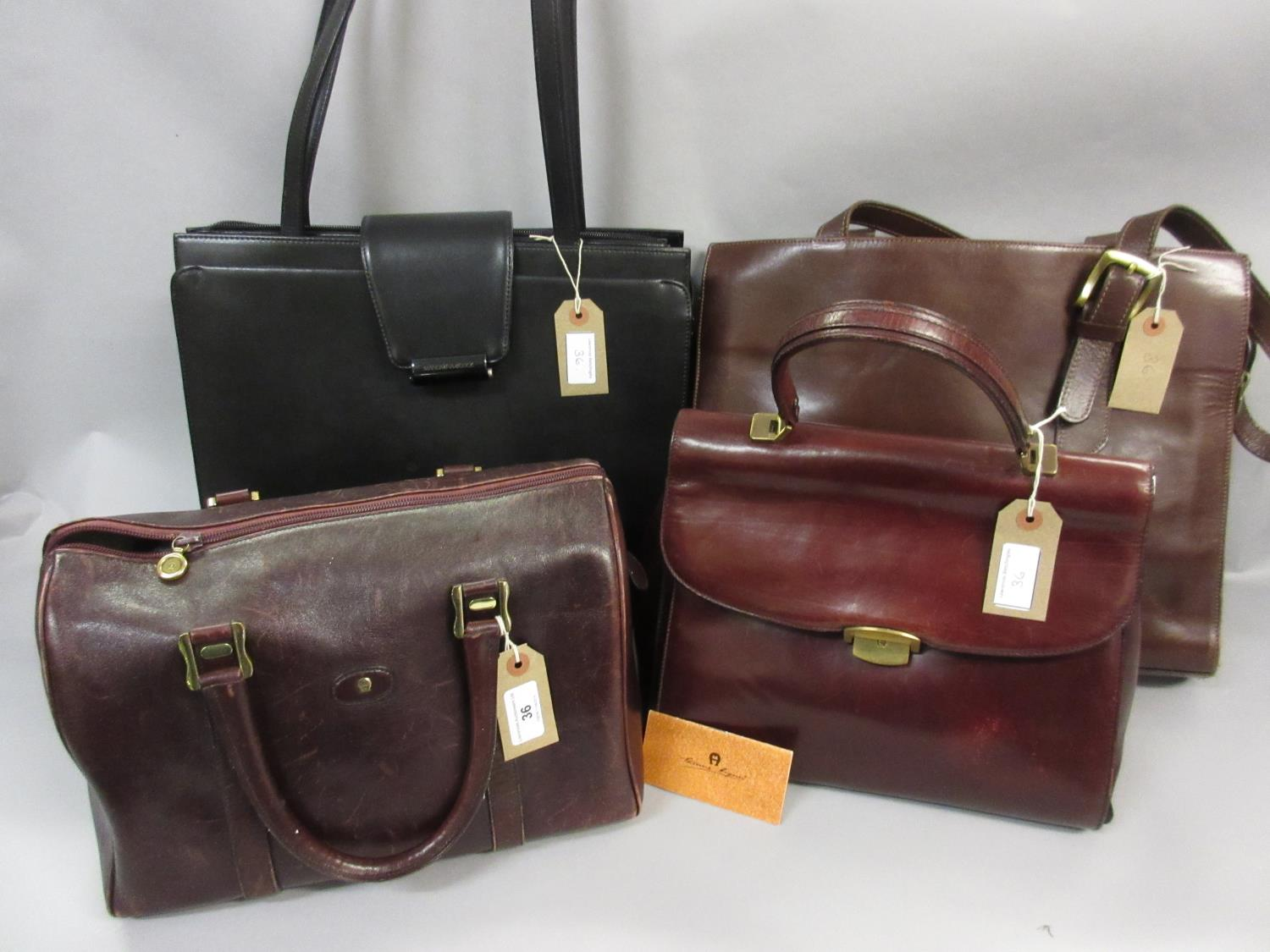 Lot 36 - Etienne Aigner, small burgundy leather holdall, another burgundy Etienne Aigner handbag, together