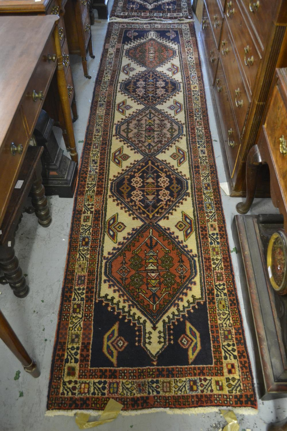 Lot 9 - Near pair of Persian runners of geometric floral design with multiple borders, 2ft 2ins x 9ft 4ins