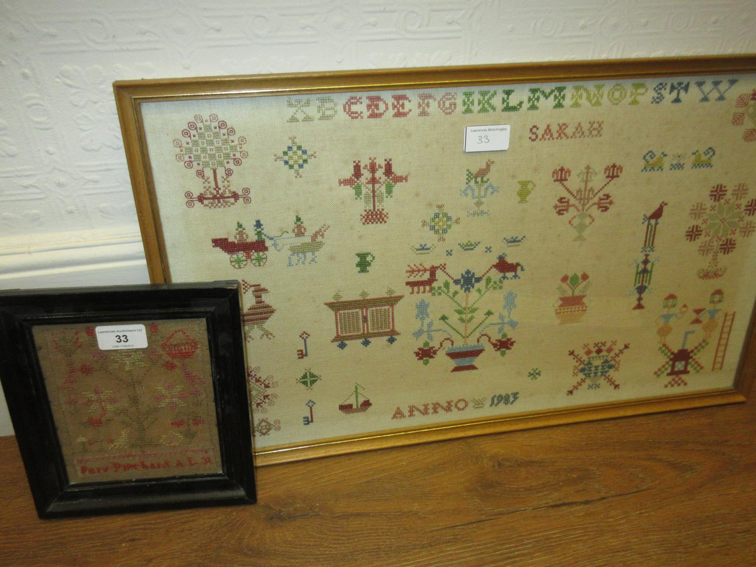 Lot 33 - Small 19th Century needlework sampler in an ebonised frame, 6ins x 5ins and a larger framed