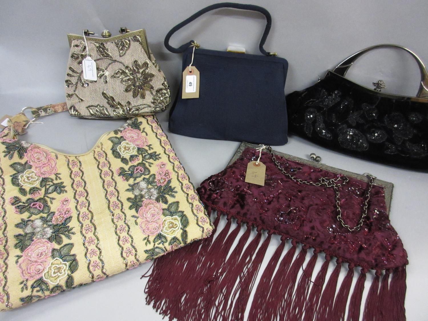 Lot 49 - 1940's / 50's navy blue Corde handbag, together with two large metal framed and beaded handbags