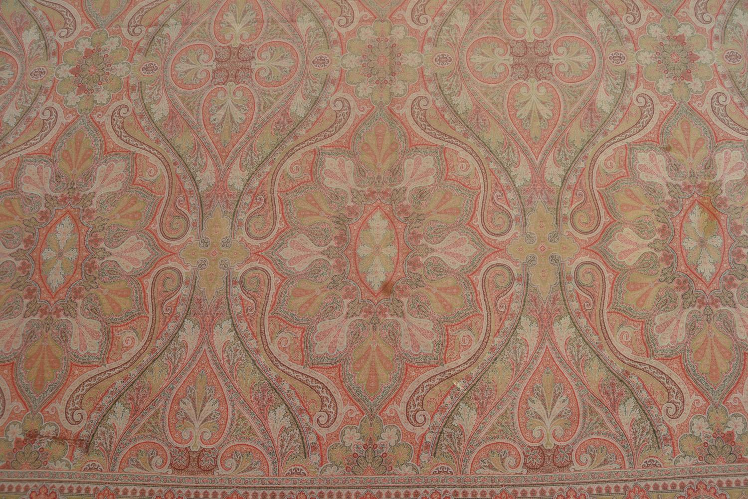 Lot 26 - Late 19th or early 20th Century Paisley shawl woven in shades of predominantly red, black, green and