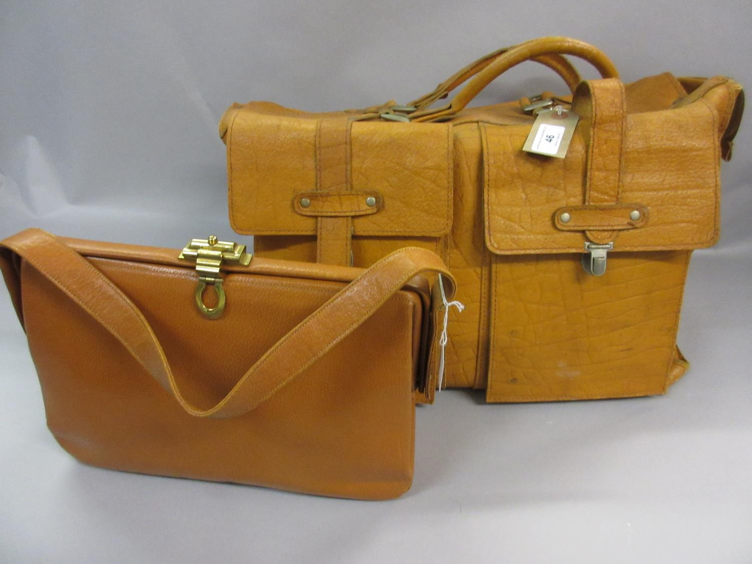 Lot 46 - Tan leather holdall together with a tan 1950 / 60's handbag, The Voyager