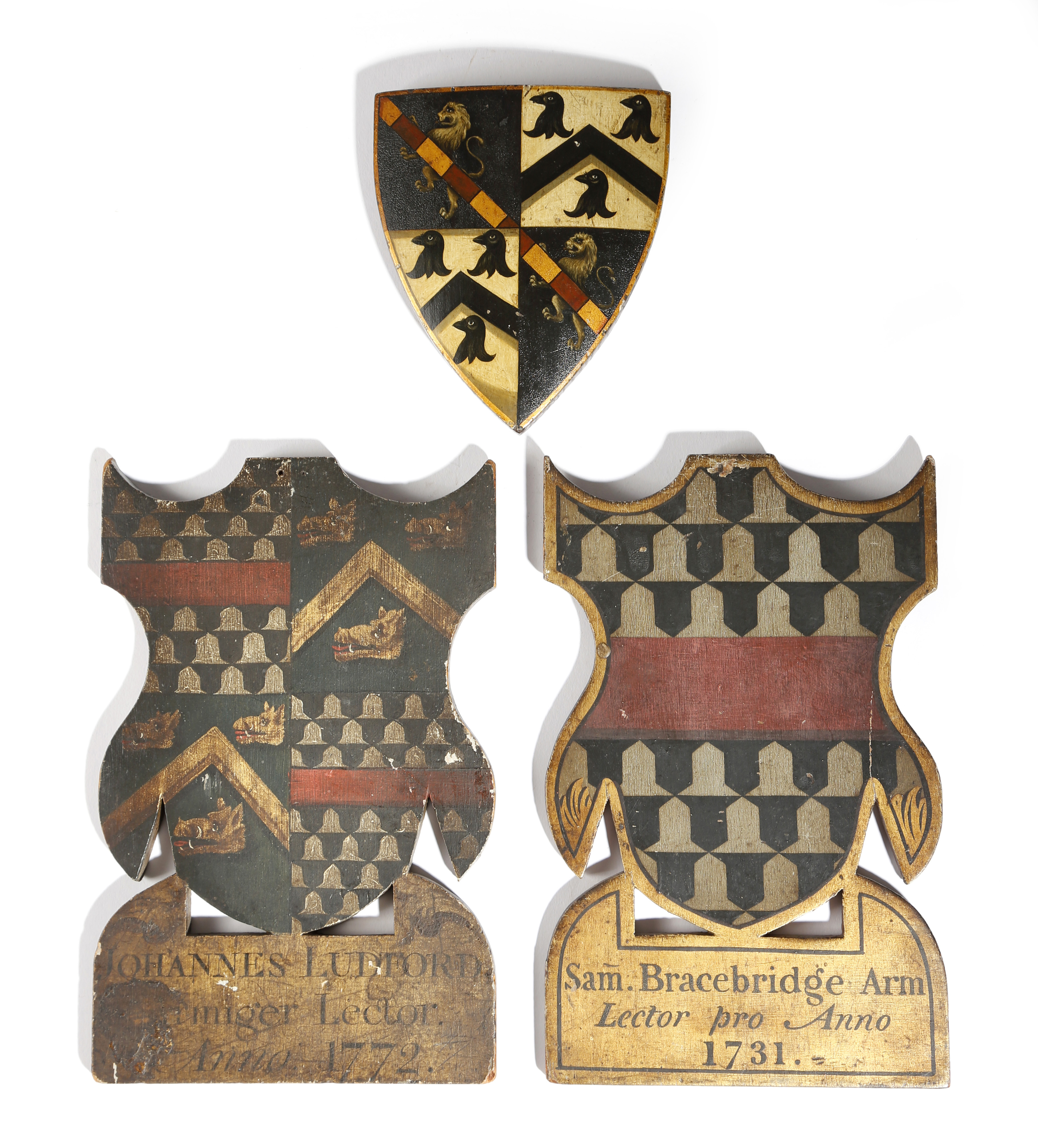 Lot 568 - Heraldry interest. Three carved and painted wood coats of arms, parcel gilt, two with