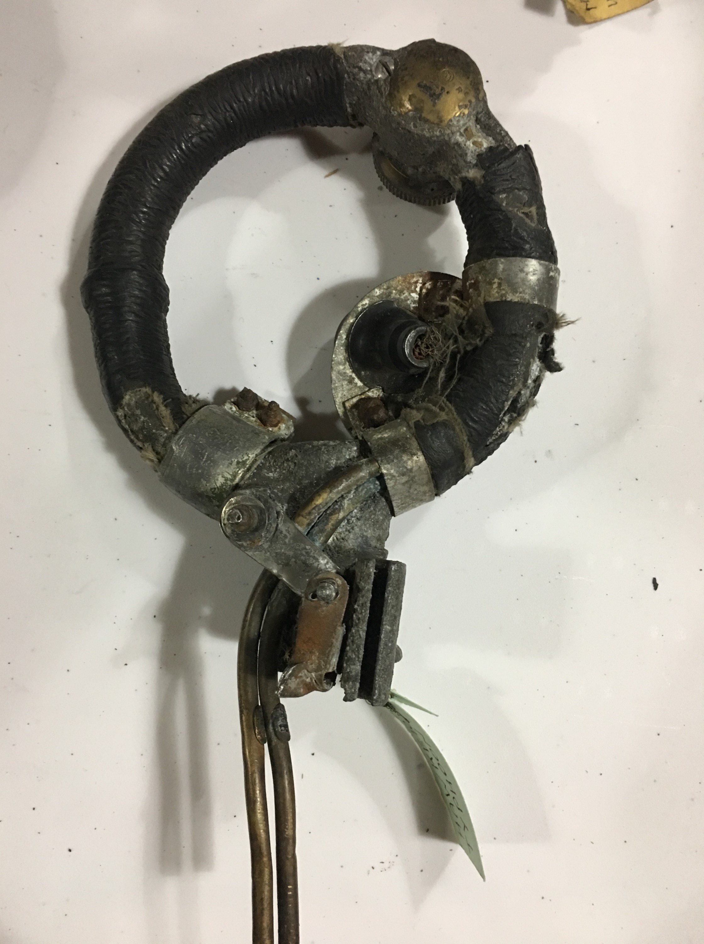 """Lot 686 - A relic RAF control column spade grip, (bearing a label with inscription """"Hawker Typhoon"""")"""