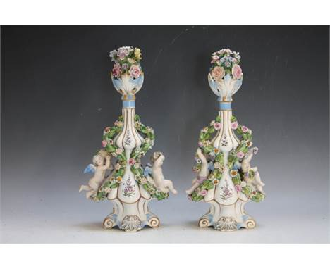A PAIR OF MEISSEN CHERUBIC EMBELLISHED DOUBLE GOURD SHAPED FLASK / VASE AND STOPPER, with encrusted floral deciration, overal