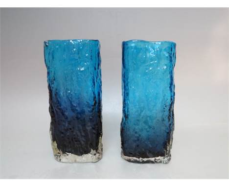A PAIR OF KINGFISHER BLUE WHITEFRIARS STYLE TEXTURED GLASS VASES, of rectangular form, H 17.5 cm, W 7.5 cm, D 4.5 cm, one wit