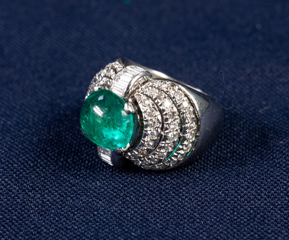 Lot 87 - PLATINUM, EMERALD AND DIAMOND COCKTAIL RING, WITH A CABOCHON OVAL NATURAL EMERALD OF VERY STRONG