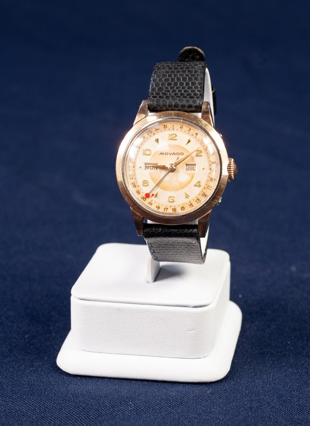 Lot 5 - a GENTS MOVADO SWISS VINTAGE WRIST WATCH, with mechanical movement, gold plated front to the