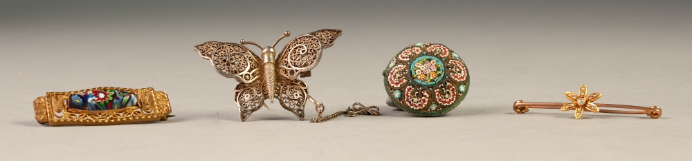 Lot 83 - VICTORIAN GOLD COLOURED METAL SAFETY PIN BROOCH, the floral centre set with seed pearls, a